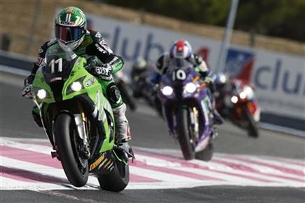 Team Kawasaki SRC on the second step
